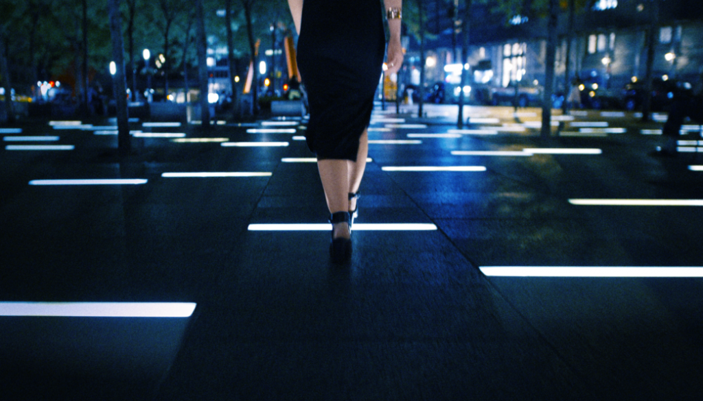 alex-youth-video-frame-rachel-walking-across-light-tiles