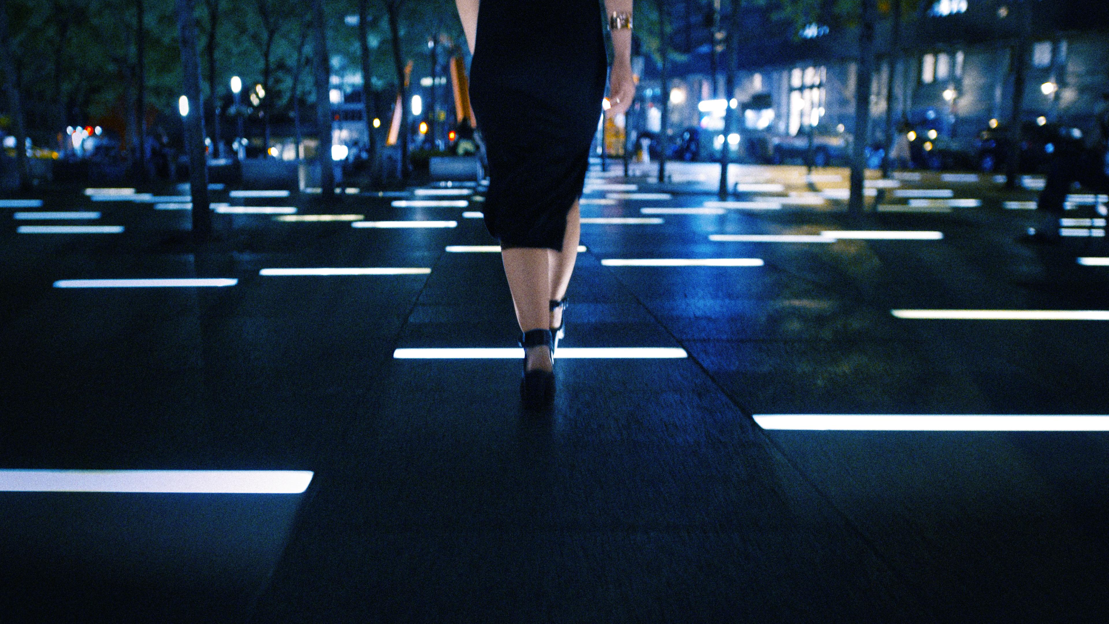 alex-youth-video-frame-rachel-walking-across-light-tiles
